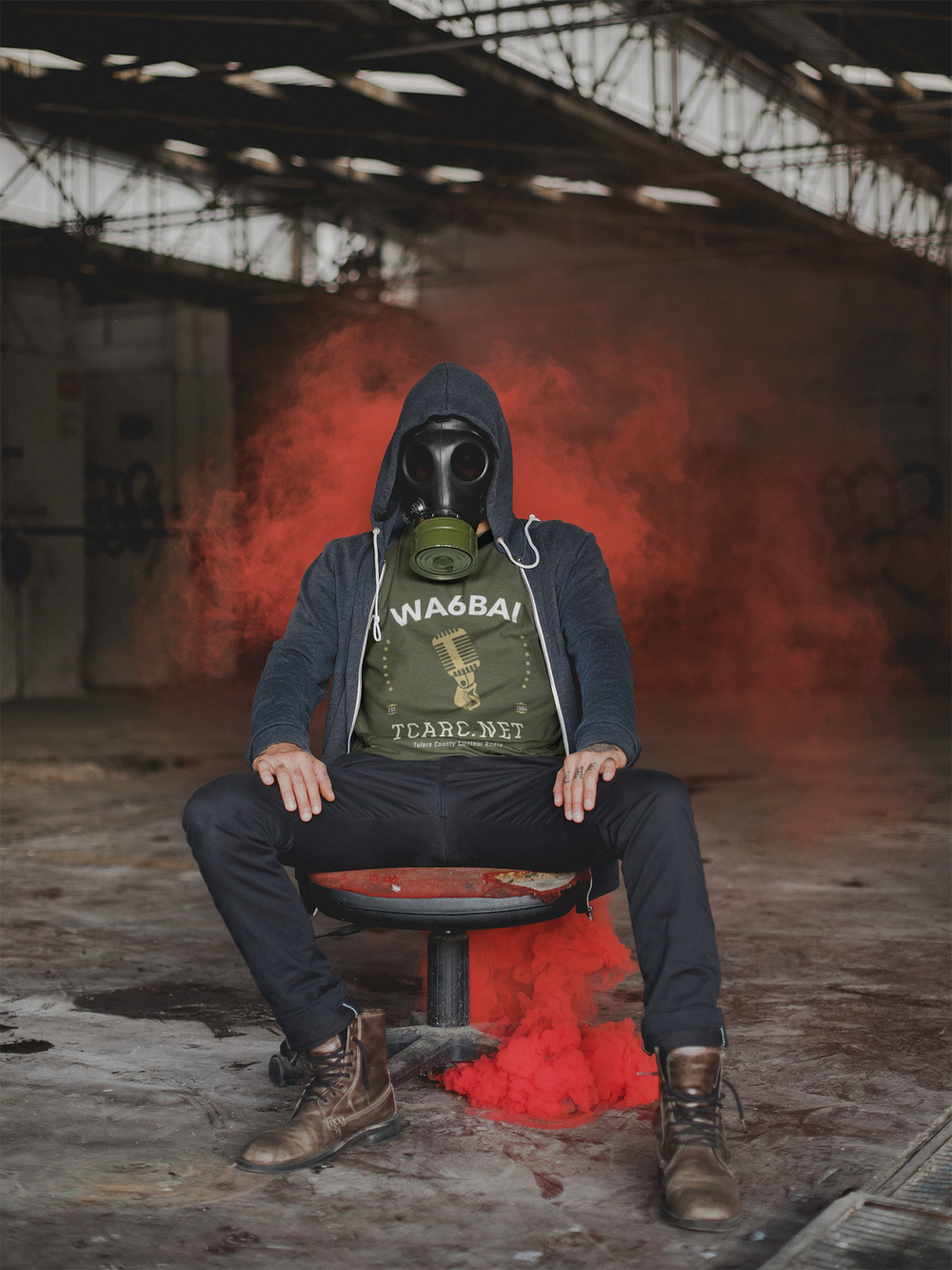 t-shirt-mockup-of-a-man-with-a-gas-mask-sitting-near-red-smoke-22946(1).jpg